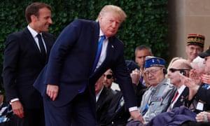 The presidents greet veterans.