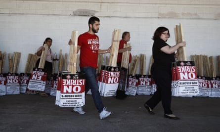 Members of the the Culinary Union carry signs at a union hall on Friday 1 June.
