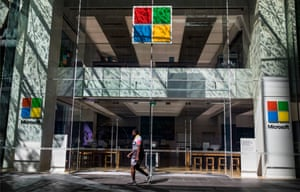 A man walks past the closed Microsoft store in the Pitt Street mall.