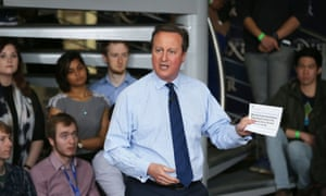 David Cameron addresses students at Exeter University, holding the offending leaflet.