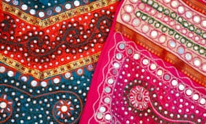 Treasured textiles: traditional fabrics on display at stall in bazaar in Jaipur, Rajasthan.