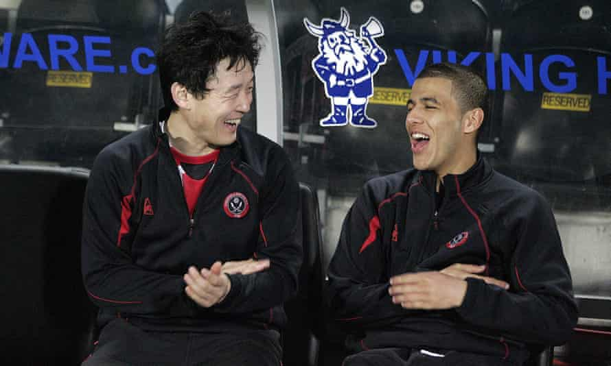 Aymen Tahar on the Sheffield United bench with Sun Jihai in 2009.