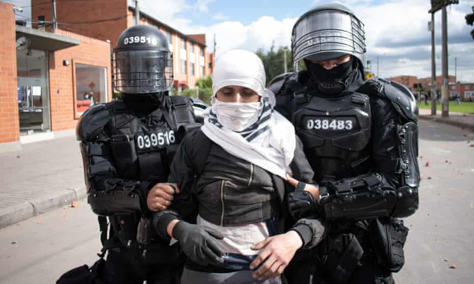 A demonstrator is arrested by Colombia's riot police in late June.