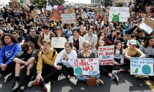 Climate change supporters march down Queen Street to Quay Street in Auckland