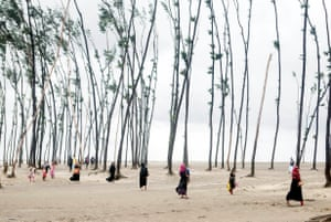 Chittagong, BangladeshPeople walk to safety on the coast after at least five people died when cyclone Mora hit the south-west of the country.