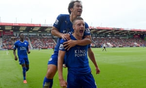 Jamie Vardy celebrates with team-mate Shinji Okazaki after scoring Leicester City's equaliser against Bournemouth at Vitality Stadium.