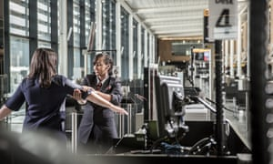 A G4S worker carries out security checks at London's Heathrow airport.