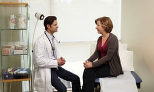 Male doctor Consults with female patient
