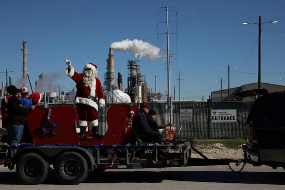 The annual town Christmas parade, organized by the local Catholic church and sponsored by Valero, takes place in the Manchester neighborhood in industrial east Houston, Texas.