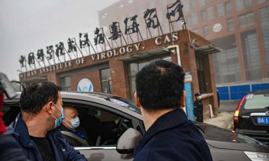 Members of the World Health Organization (WHO) team investigating the origins of the Covid-19 coronavirus arrive by car at the Wuhan Institute of Virology