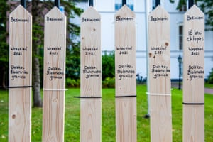 Six wooden stakes placed in front of the Polish embassy in The Hague, the Netherlands, to remember refugees that have died at the border between Belarus and Poland