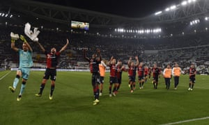 Genoa players greet their fans after their 1-1 draw at Juventus.