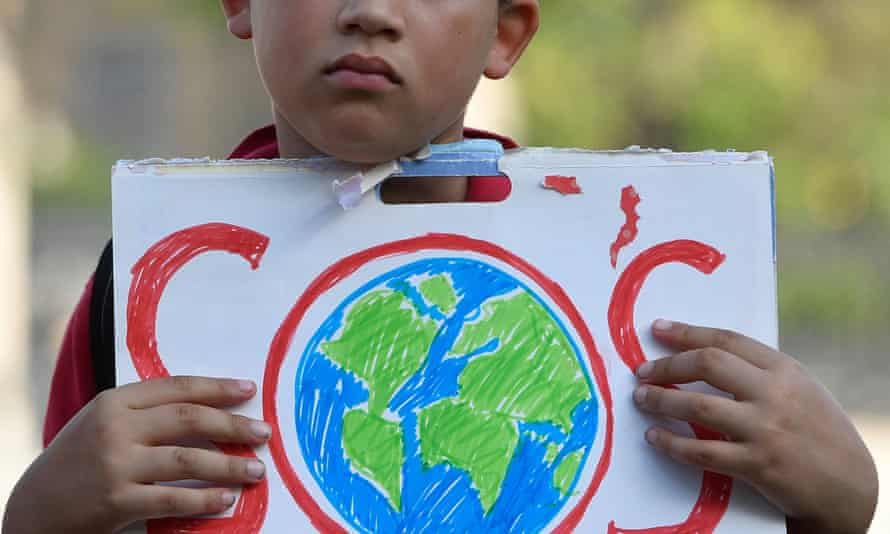 A young person at a climate protest outside Parliament in London, 8 September 2021.