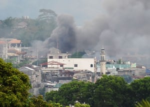 Smoke rises near a public market after military helicopters fired rockets on the positions of Muslim extremists in Marawi,