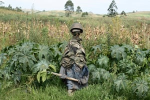 The likeness of a Congolese soldier stands in a field near the village of Tche in Congo's north-eastern Ituri province in mid-February. With few government forces in the area, villagers from the Hema community erected the likeness in the hopes of warding off armed members of the Cooperative for the Development of Congo (Codeco), an armed political-religious sect drawn from the Lendu ethnic group that has been blamed for a wave of killings in the province over the past two years.