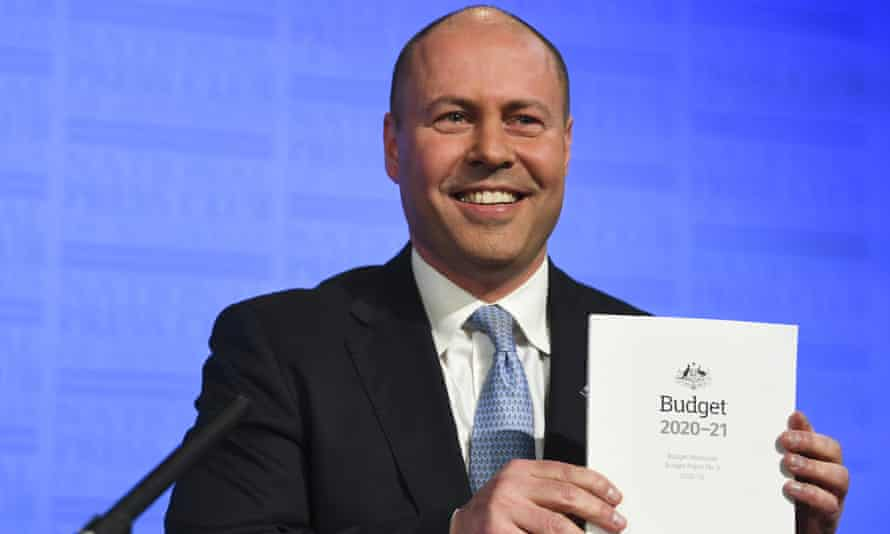 Treasurer Josh Frydenberg holds the 2020-21 budget papers at the National Press Club in Canberra