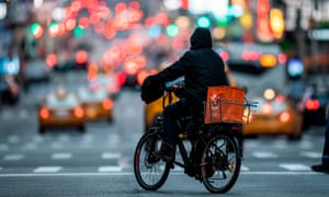 Food delivery workers have become essential in New York after the city closed restaurants and bars to the public on 16 March.