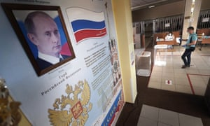 A portrait of Vladimir Putin at a polling station in Moscow