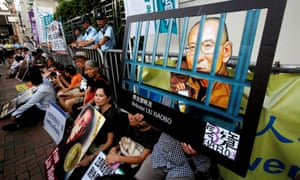 Pro-democracy activists in Hong Kong stage a sit-in demanding the release of Nobel laureate Liu Xiaobo.