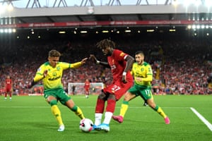 Divock Origi of Liverpool crosses the ball leading to the own goal of Grant Hanley of Norwich City.