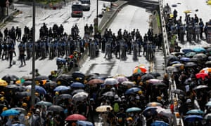 Riot police and protesters face each other on Harcourt Road during the anniversary of Hong Kong's handover to China in Hong Kong.