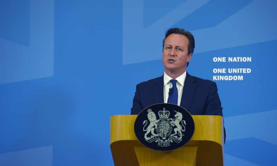 David Cameron standing at a podium