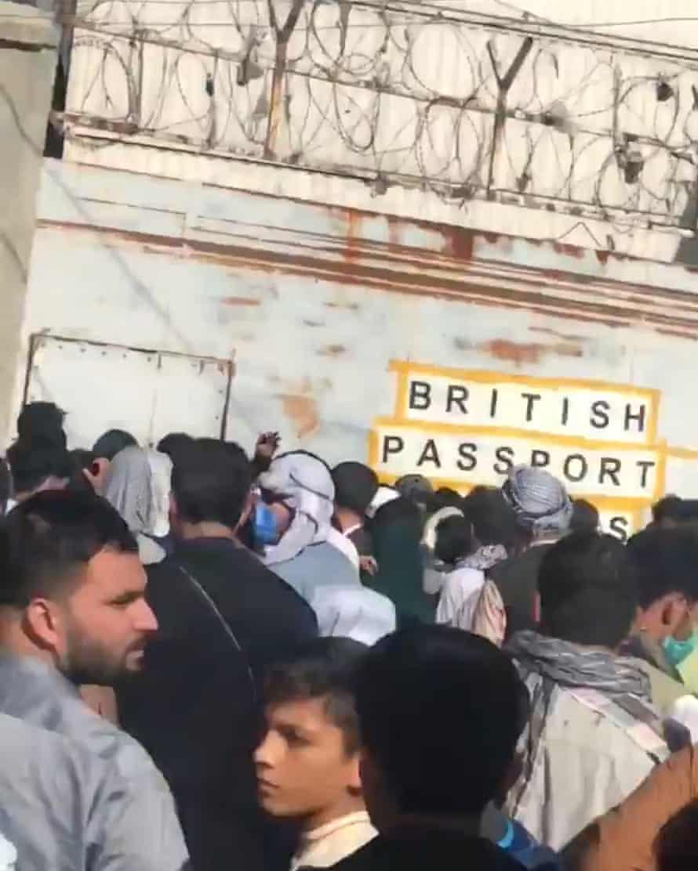 People queue near 'British passport holders' sign