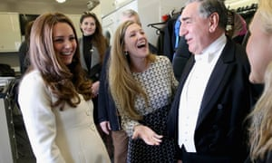 The Duchess of Cambridge chats to actor Jim Carter (who plays Carson) during a visit to the set of Downton Abbey at Ealing Studios.