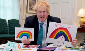 Boris Johnson displaying his Get Well Soon cards sent in by children while he was ill with Covid-19