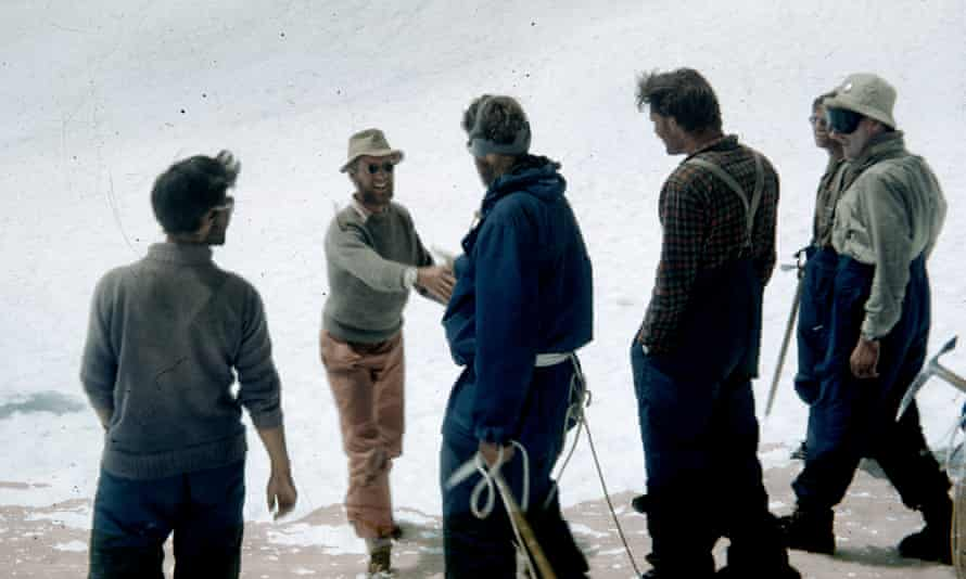 James (now Jan) Morris shaking Edmund Hillary's hand on a snowy slope