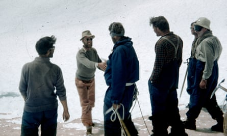 James (now Jan) Morris shaking hands with Edmund Hillary on a snowy slope