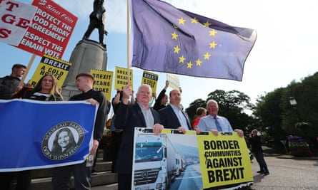 Border Communities Against Brexit members protest in Belfast during Boris Johnson's visit on 31 July.