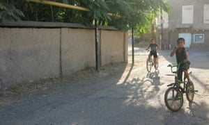 Children play on the streets of Olmazor, a centuries-old mahalla in the centre of Tashkent.
