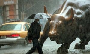 wall street bull in the rain