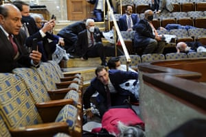 People shelter in the House gallery as the mob tries to break into the House chamber.