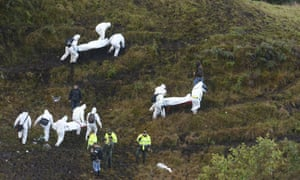 Rescue workers carry the boris of victims of an airplane that crashed in La Union, a mountainous area outside Medellin, Colombia,