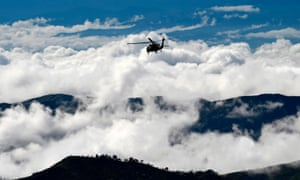 Thick clouds stopped Juan Manuel Santos's helicopter from landing.