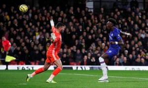 Chelsea's Tammy Abraham sidefoots the ball over Ben Foster.