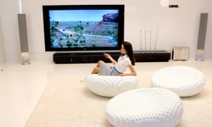 Woman in front of a large TV