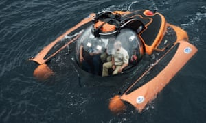 Away they go: the crew of the submersible – with President Putin alongside them – guide the C-Explorer submersible near to where the shipwreck lies