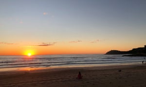 Sunrise at Manly beach in July. In the distance you can see the headland off Shelly Beach which protects the waters for the ocean swimmers between Manly and Shelly.