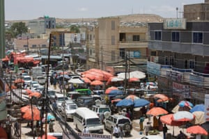 Market stalls and traffic in Hargeisa's bustling downtown area.