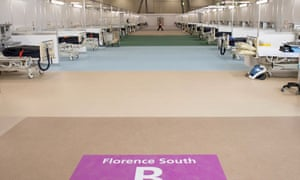 Beds are set up by members of the military and private contractors inside the ExCel centre in London, which has been transformed into a field hospital to be known as the NHS Nightingale Hospital, to help with the novel coronavirus COVID-19 pandemic.