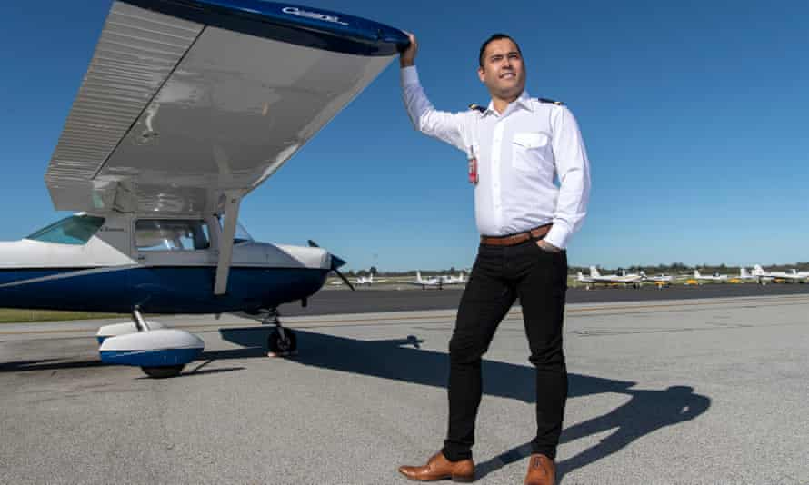 Portrait of Max Sylvester in front of the plane he landed, during his first flying lesson, after the pilot became unconscious.