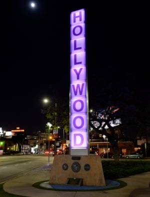 Los Angeles, USA Hollywood sign is illuminated in purple.