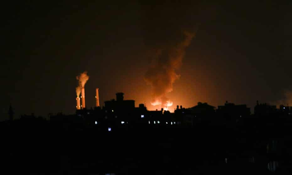 A column of smoke seen from Gaza city billows from an oil facility in the southern Israeli city of Ashkelon