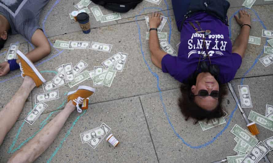 Protesters stage a die-in outside the courthouse where the Purdue Pharma bankruptcy case took place.