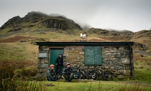 Mountain bikers on a litter pick on Helvellyn, UK