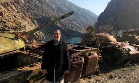 Abdullah Anas beside a tank in Afghanistan's Panjshir valley