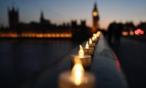 Candles lie along Westminster Bridge